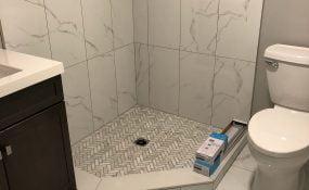 Bathroom Reno Herringbone Shower Floor and Large Format Tiles