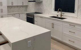 Herringbone Marble Tile Backsplash in Kitchen